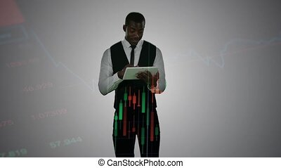 African american broker working with tablet double exposure over financial data graphs