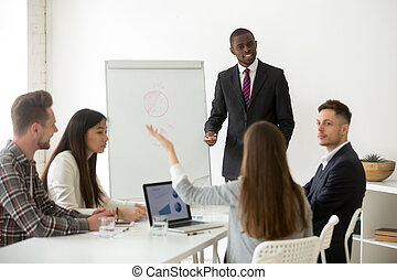 African american business coach answering questions at corporate