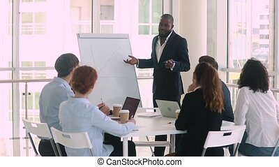 African american business coach presenting project result to...