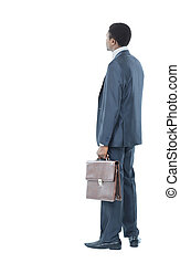 African American business man from the back looking at something isolated white background