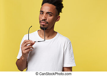 African american business man holding a glass, isolated on yellow background - Black people