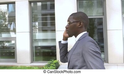 African American business man making a mobile  phone call - Black people