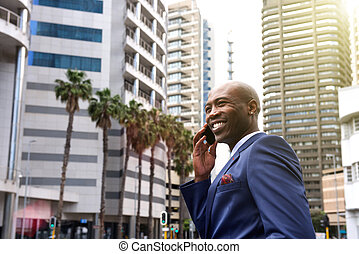 African american business man talking on mobile phone in the city