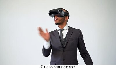 African-american Business man using a virtual reality VR headset