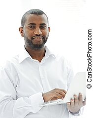 African American business man with a laptop - African...