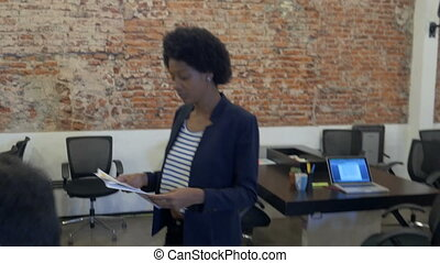 African american business woman give papers asian man colleague