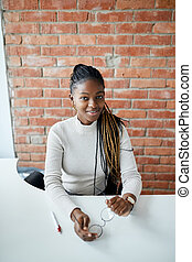 African-American business woman looking at the camera