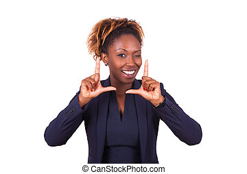 African American business woman making frame gesture with her hands