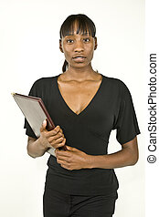 An attractive African American office worker, business woman or student ready to take notes.