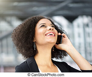 African american business woman talking on cellphone