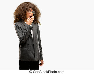 African american business woman wearing glasses bored yawning tired covering mouth with hand. Restless and sleepiness.