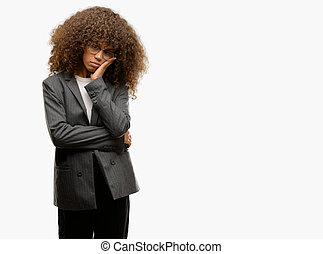 African american business woman wearing glasses thinking looking tired and bored with depression problems with crossed arms.