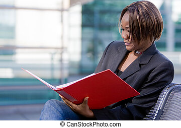 African american business woman with folder
