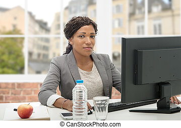 African American business woman working with computer