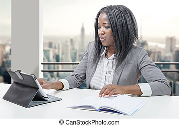 African american business woman working with tablet