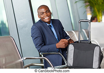african American businessman airport - happy african...