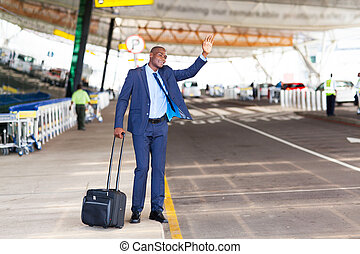 businessman calling taxi in airport - african american ...