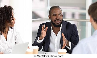 African american businessman coach negotiator speaking at diverse team meeting
