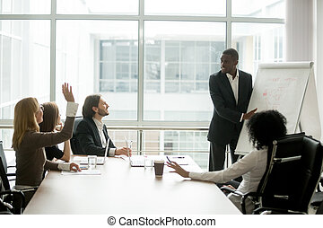African-american businessman giving presentation answering quest