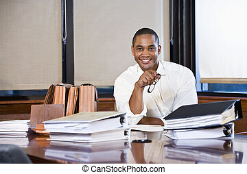 African American businessman reading documents