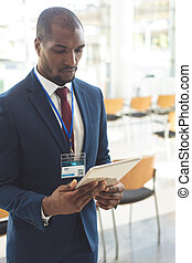 African-american businessman standing in conference room