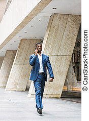 African American businessman traveling, working in New York