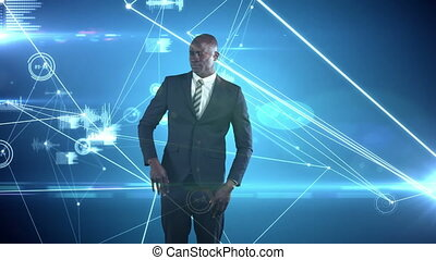 African American businessman using touch technology and inspecting