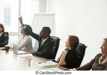 African-american businessman volunteer raising hand at corporate