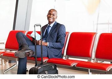 african American businessman waiting flight