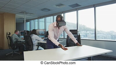African American businessman wearing VR headset in modern ...