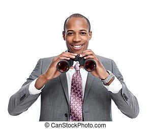 African-American businessman with binoculars.