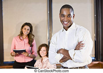 African American businessman with coworkers