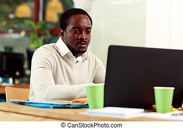 African american businessman working on his laptop in office