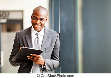 businessman writing report in office