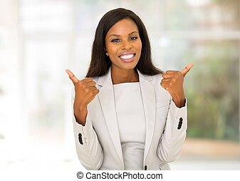 african american businesswoman giving thumbs up
