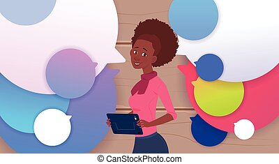 African American Businesswoman Holding Tablet Speak Over Colorful Chat Bubbles