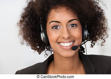 African American businesswoman in a headset - Close up ...