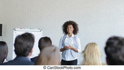 African American Businesswoman Leading Presentation Explain Group Of Business People New Strategy During Conference Meeting