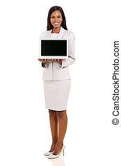 african american businesswoman presenting laptop