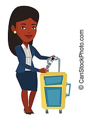 African-american businesswoman showing luggage tag