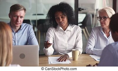 African american businesswoman talking to clients explain deal benefit convince diverse partners at group negotiation meeting, black manager consult customers discuss startup idea promise good result