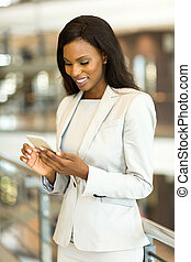 african american businesswoman using smart phone in office