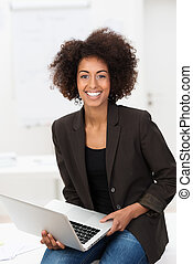 African American businesswoman with a laptop