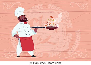 African American Chef Cook Holding Frying Pan With Hot Food Smiling Cartoon In White Restaurant Uniform Over Wooden Textured Background