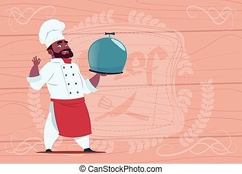 African American Chef Cook Holding Tray With Dish Smiling Cartoon In White Restaurant Uniform Over Wooden Textured Background