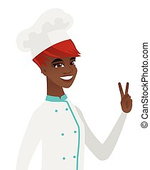 African-american chef cook showing victory gesture