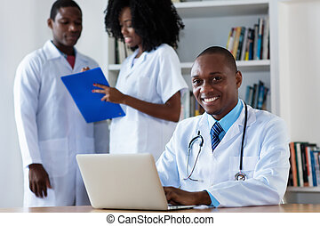 African american chief physician with medical team