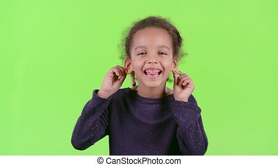 African american child showing tongue. Green screen -...
