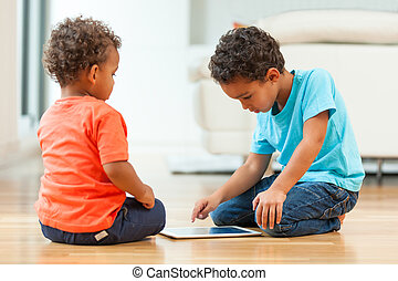 African american childrens using a tactile tablet