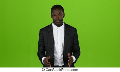 African american claps his hands and shows his fingers up. Green screen